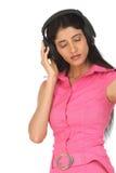 Muchacha india que disfruta de música Fotografía de archivo
