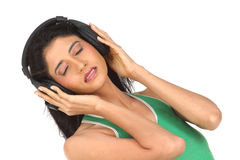 Muchacha india que disfruta de música Foto de archivo libre de regalías