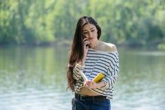 Muchacha infeliz con el teléfono móvil Imágenes de archivo libres de regalías