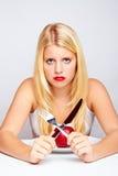 Muchacha infeliz con la manzana roja Imagen de archivo