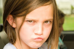 Muchacha infeliz/el poner mala cara Fotos de archivo