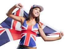 Muchacha inglesa alegre con una bandera Imagen de archivo libre de regalías