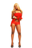 Muchacha jamaicana joven en rojo   Foto de archivo