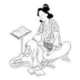 Muchacha japonesa con un libro Fotografía de archivo