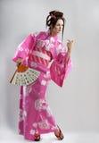Muchacha japonesa joven con la fan Imágenes de archivo libres de regalías