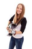 Muchacha hermosa con la guitarra en el fondo blanco Foto de archivo libre de regalías