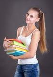 Muchacha joven del adolescente con los libros Imágenes de archivo libres de regalías