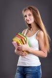 Muchacha joven del adolescente con los libros Foto de archivo