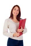Muchacha joven del estudiante con la carpeta roja Fotos de archivo libres de regalías