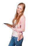 Muchacha joven del estudiante de la belleza con la tablilla Foto de archivo libre de regalías