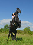Muchacha joven del montar a caballo Imágenes de archivo libres de regalías