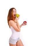 Muchacha joven, deportiva, apta y hermosa con las manzanas aisladas en wh Imagen de archivo libre de regalías