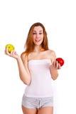 Muchacha joven, deportiva, apta y hermosa con las manzanas aisladas en wh Fotografía de archivo libre de regalías