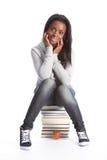Muchacha joven feliz del estudiante con los libros de la educación Fotografía de archivo