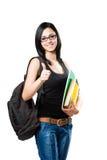 Muchacha joven hermosa del estudiante que muestra los pulgares para arriba. Imagen de archivo