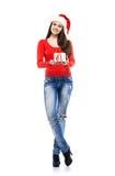 Muchacha joven y atractiva del adolescente con un regalo de Navidad Imagenes de archivo