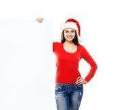 Muchacha joven y atractiva del adolescente con una cartelera en blanco Imagen de archivo