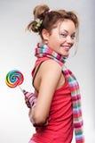 Muchacha juguetona con el lollipop Imágenes de archivo libres de regalías