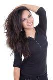 Muchacha latina que presenta con el pelo marrón en un lado Fotos de archivo