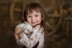 Muchacha linda con el conejo Fotos de archivo