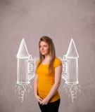 Muchacha linda con el ejemplo del dibujo del cohete del paquete del jet Foto de archivo libre de regalías