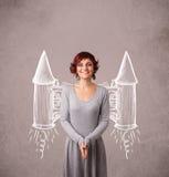 Muchacha linda con el ejemplo del dibujo del cohete del paquete del jet Foto de archivo
