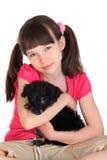 Muchacha linda con el perro de animal doméstico Fotos de archivo libres de regalías