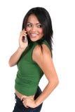 Muchacha linda con el teléfono celular fotografía de archivo libre de regalías