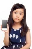 Muchacha linda con el teléfono elegante imagen de archivo libre de regalías