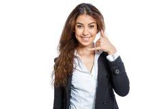 Muchacha linda con la mano como teléfono Imágenes de archivo libres de regalías