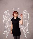 Muchacha linda con las alas ilustradas ángel Fotografía de archivo libre de regalías