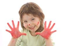 Muchacha linda con las manos y la cara pintadas Imagenes de archivo
