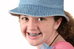Muchacha linda con las paréntesis Fotos de archivo libres de regalías