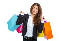 Muchacha linda con los bolsos de compras Imagen de archivo libre de regalías