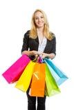 Muchacha linda con los bolsos de compras Fotos de archivo libres de regalías