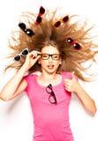 Muchacha linda con los vidrios del pelo rizado y del inconformista Imagen de archivo libre de regalías