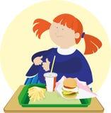 Muchacha linda con una hamburguesa. Imagen de archivo