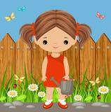 Muchacha linda con una regadera Jardinería Imágenes de archivo libres de regalías