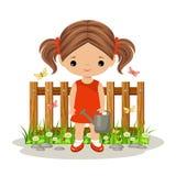 Muchacha linda con una regadera Jardinería Foto de archivo libre de regalías
