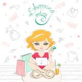 Muchacha linda de la historieta que hace compras en línea en el fondo Fotos de archivo libres de regalías