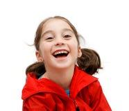 Muchacha linda de risa con las coletas Foto de archivo libre de regalías