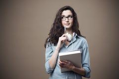 Muchacha linda del estudiante que toma notas Imágenes de archivo libres de regalías