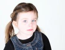 Muchacha linda del niño que mira la cámara Imagenes de archivo
