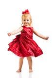 Muchacha linda en alineada roja Imagen de archivo