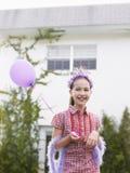 Muchacha linda en el globo de Tiara And Feather Boa With Imágenes de archivo libres de regalías