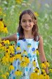Muchacha linda en el jardín Fotos de archivo