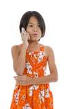 Muchacha linda en el teléfono Foto de archivo libre de regalías
