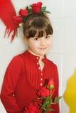 Muchacha linda en el traje rojo de Rose Fotografía de archivo libre de regalías