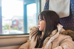 Muchacha linda en el tren Imágenes de archivo libres de regalías