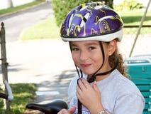 Muchacha linda en un casco Foto de archivo libre de regalías